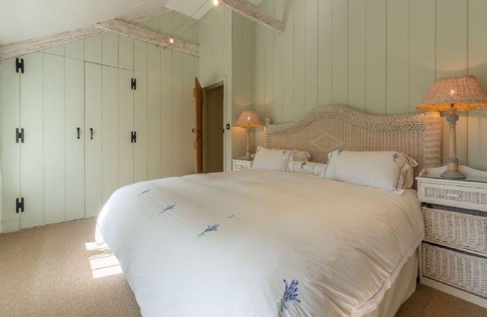 First floor: Double bedroom with 6' super-king bed and en-suite shower room