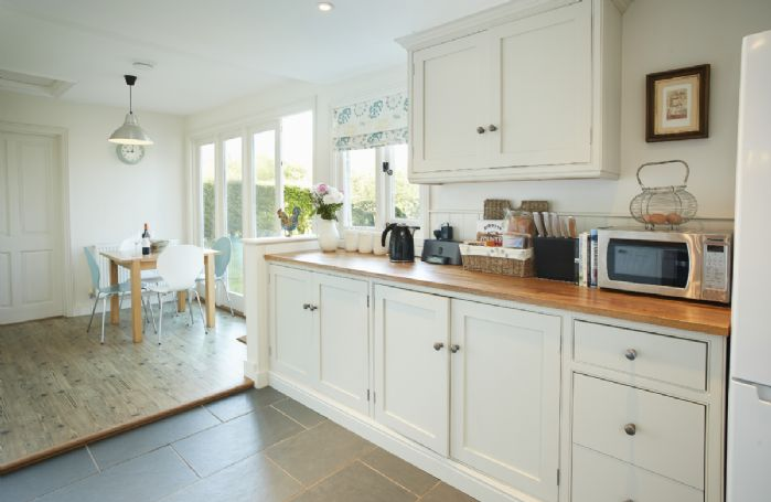 Ground floor: Fully fitted kitchen with separate breakfast table and chairs