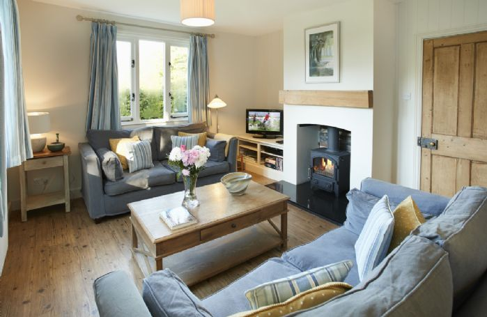 Ground floor: Open plan sitting room with wood burning stove and dining area