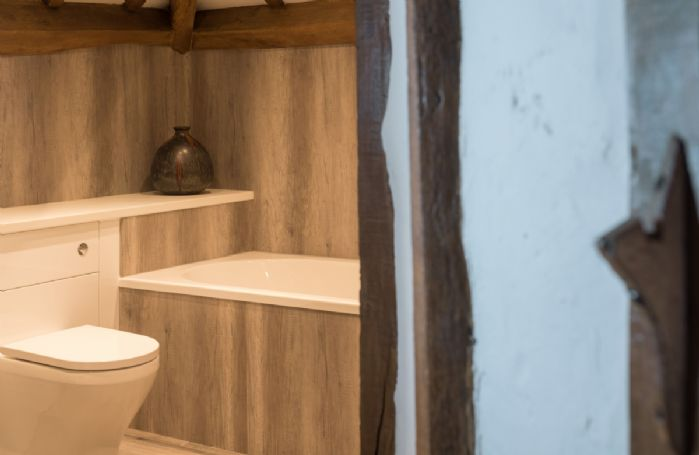 Second floor: Master en-suite bathroom with bath and separate shower
