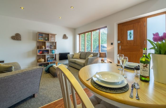 Ground floor: The light and airy open plan sitting and dining room