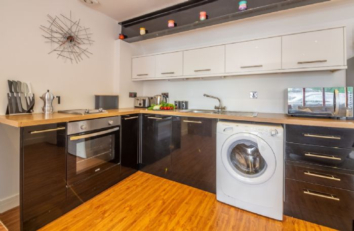 Ground floor: Fully fitted modern kitchen with washing machine