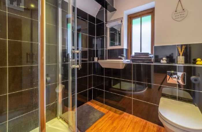 Ground floor: Bathroom with an enclosed shower and heated towel rail