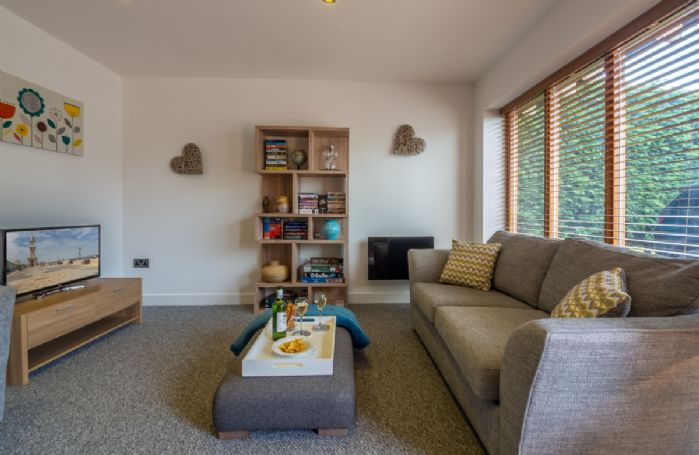 Ground floor: The spacious sitting room with floor to ceiling windows