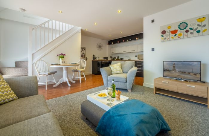 Ground floor: The spacious interior at Beau View Cottage and stairway up to the bedroom