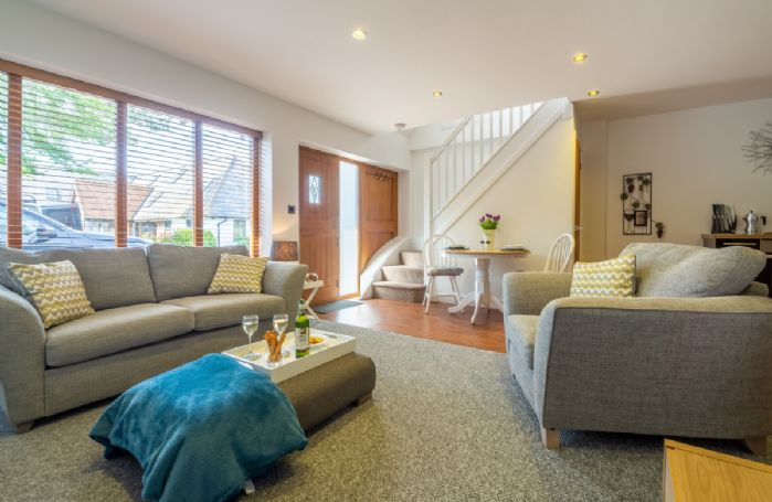 Ground floor: The cosy and comfortable open plan living area with floor to ceiling windows