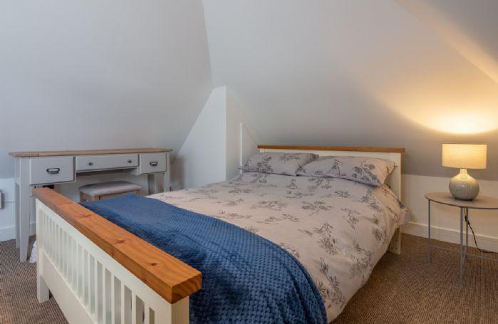 First floor: Double bedroom in the upstairs cosy loft room