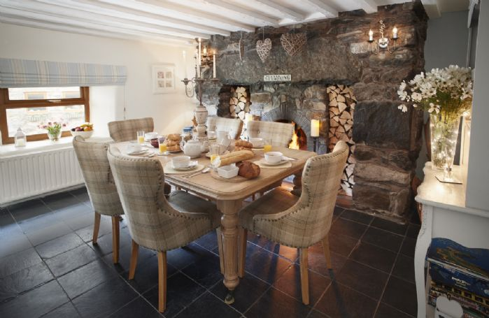 Ground floor: Dining room with table seating six guests and open fire