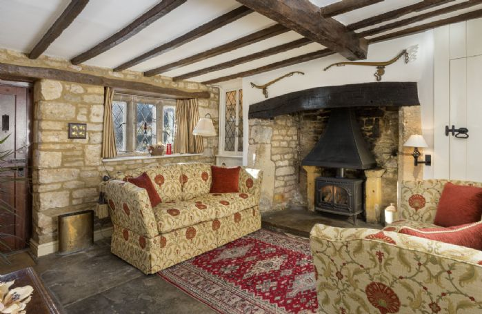 Ground Floor: Sitting room with gas effect wood burning stove and original beams