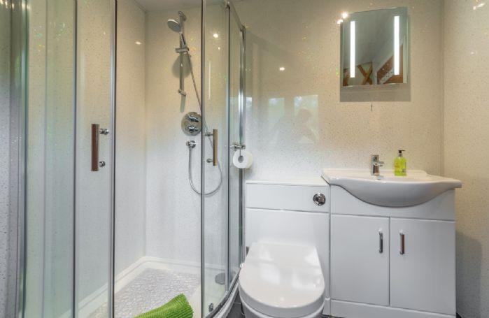 Ground floor:  Bathroom with shower, flushing toilet, underfloor heating and opening window