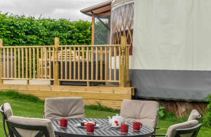 Garden furniture with table and chairs seating four guests