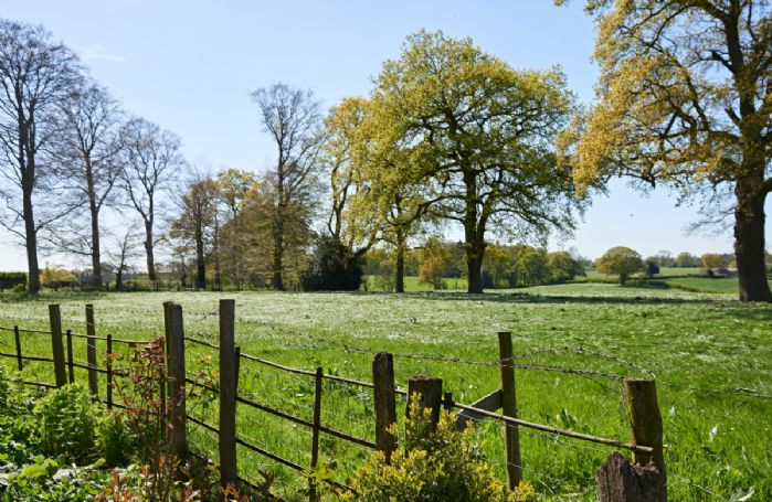 Rolling countryside surrounds Sugnall Hall