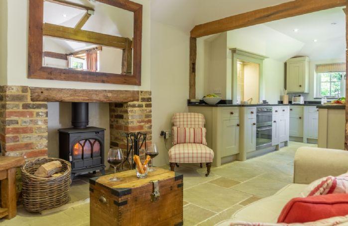 Ground floor: Open plan living area with wood burner and original oak beams