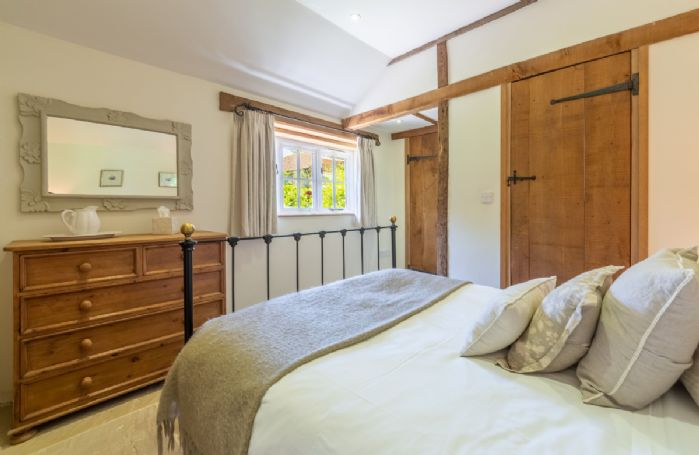 Ground floor: Charming double bedroom with beautiful cast iron bed and views across the garden
