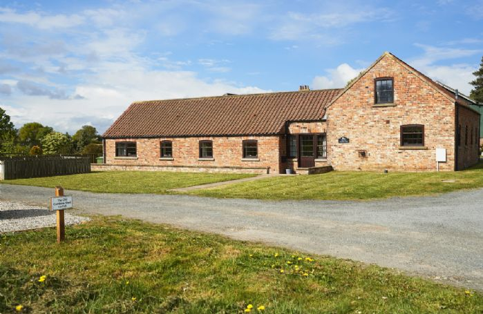 The Old Combine Shed is a light and spacious barn conversion of mellow North Yorkshire brick