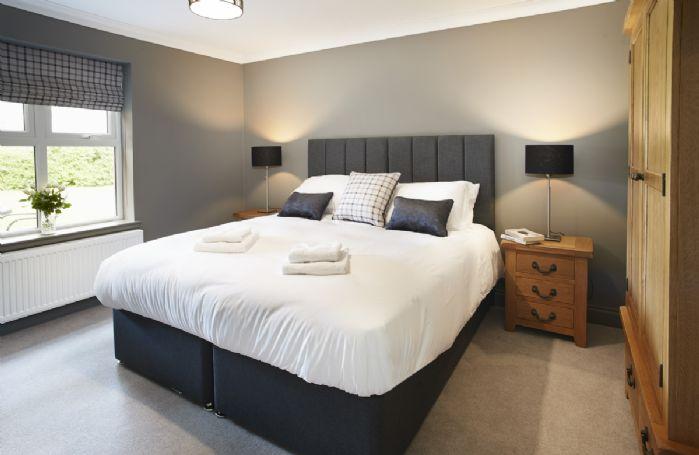 Ground floor: Master bedroom with super king size zip and link bed and en-suite shower room