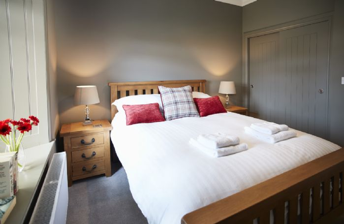 Ground floor: Double bedroom with king size bed
