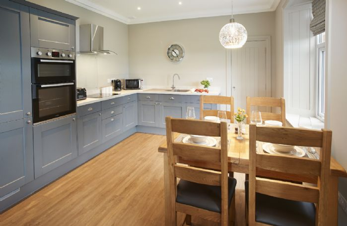 Ground floor: Fully equipped  kitchen with dining table and chairs seating four guests