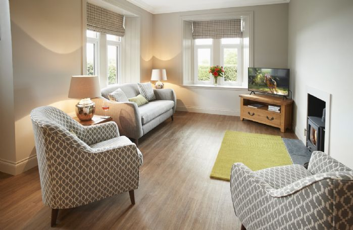 ground floor: Spacious open-plan living area with wood-burning stove