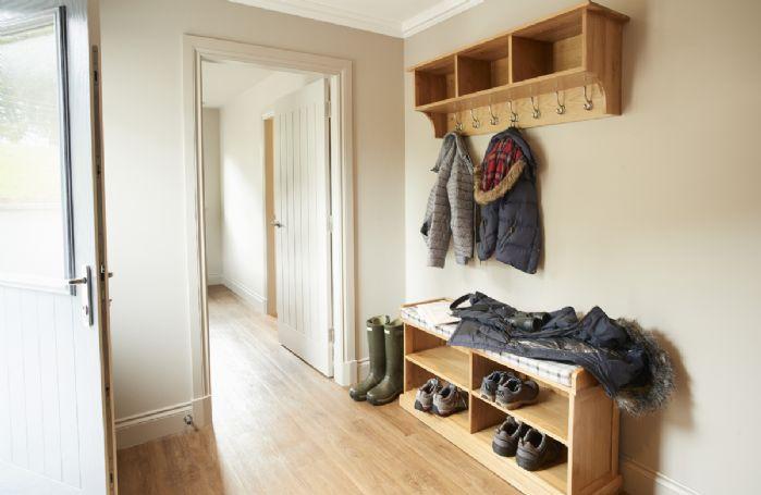 Ground floor: Large entrance hallway with plenty of coat and shoe storage