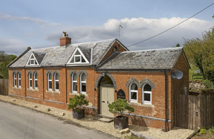 The Old Chapel boasts a number of period features including exposed beams, central fireplace and stained-glass windows