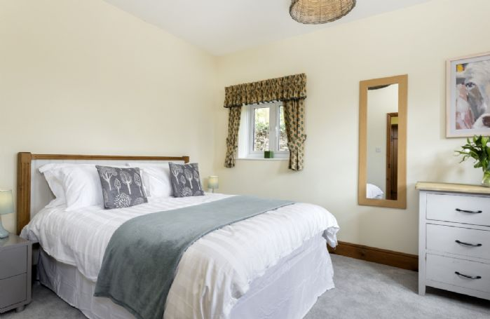 Ground floor: Spacious bedroom with double bed