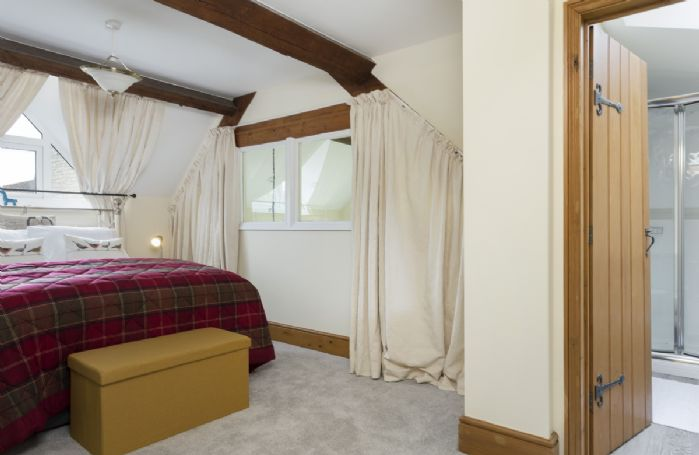 First floor: Master bedroom with king size bed and en-suite shower room