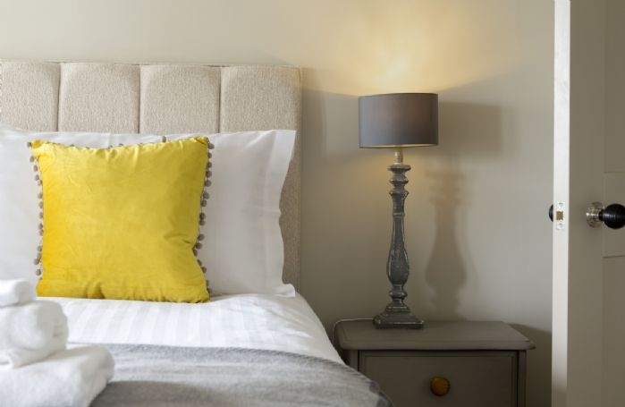 Cosy lightling and plush furnishings at Fleece Cottage