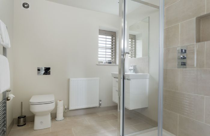 First floor: Large shower cubicle, wash basin, WC and underfloor heating