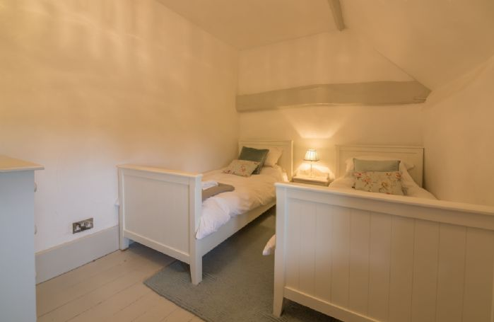 First floor: Second bedroom with twin beds, ideal for guests needing a bit of extra space