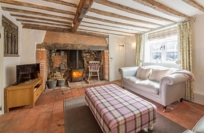 Ground floor: Sitting room with brick inglenook fireplace and wood burning stove