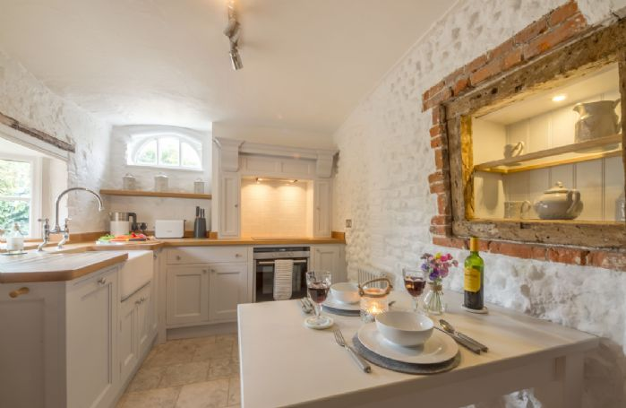 Ground floor: Bespoke painted kitchen with original exposed brick features