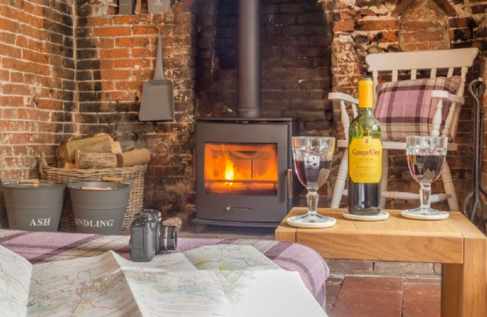 Cosy up with a glass of wine in front of the wood burning stove