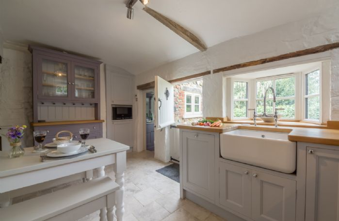 Ground floor: Bespoke painted and fitted kitchen with marble flooring and stable door to rear courtyard garden