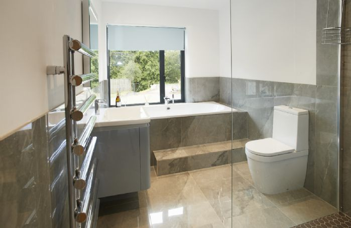 Ground floor: En-suite bathroom with sunken bath and walk in shower