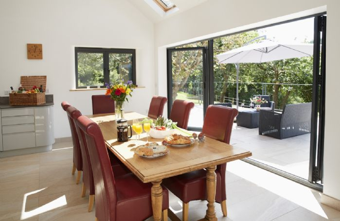 Ground floor: Dining table and chairs seating seven guests
