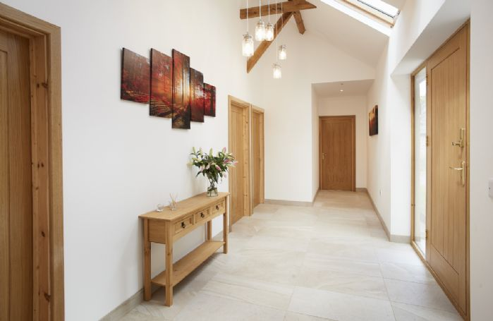 Ground floor: The spacious hallway with feature lighting