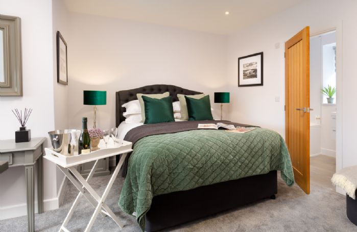 First floor: Double bedroom with king size bed and en-suite shower room