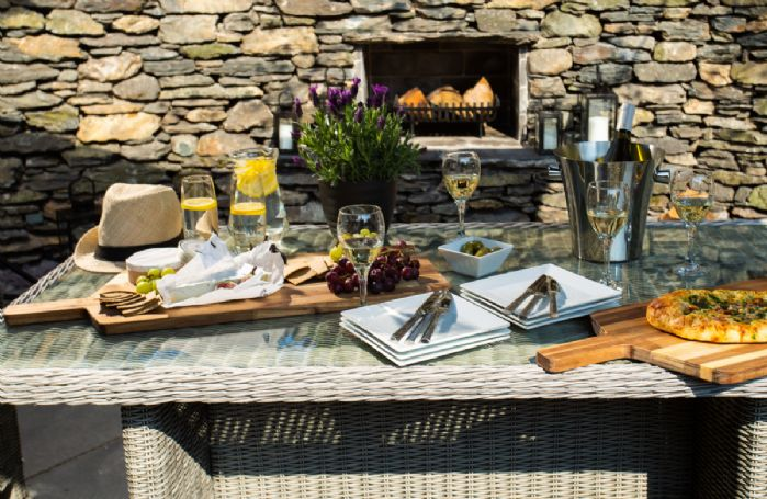 Enjoy delicious aperitifs al fresco by the outdoor fireplace
