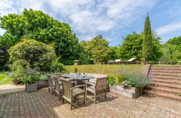 Enjoy the garden views from the seating area