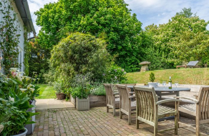 Enjoy the stunning garden views from the seating area
