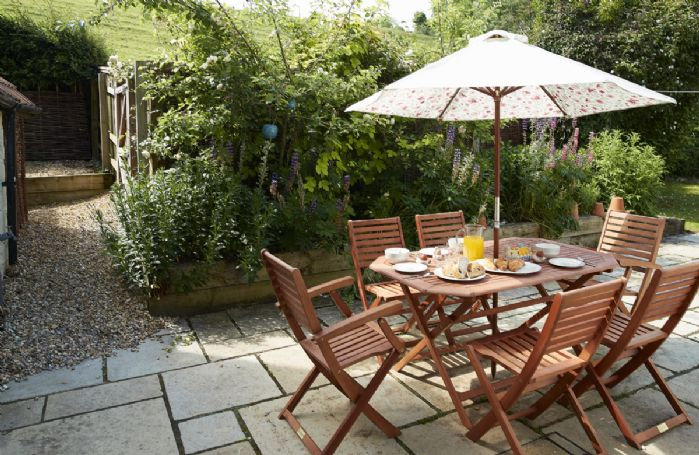 Garden table on the rear patio with seating for six guests