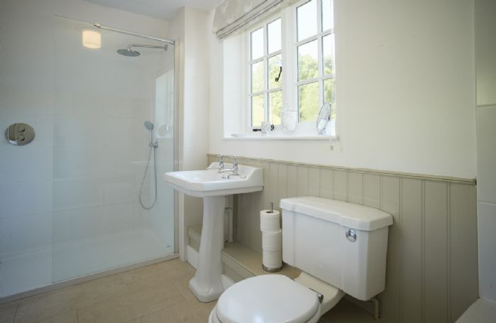 First floor: Family bathroom with bath and separate walk in shower enclosure