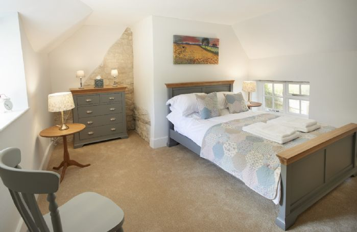 First floor: Spacious bedroom with double bed
