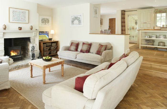 Ground floor: Spacious sitting room with log burning stove and french doors