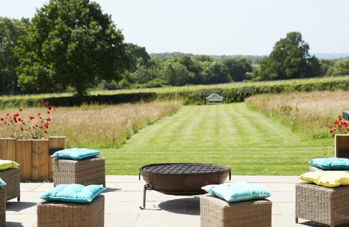 The sun terrace affords stunning views across open countryside