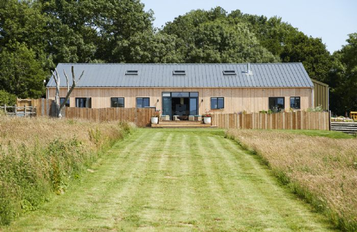 Bokes Barn is a luxurious contemporary barn conversion overlooking 80 acres of vineyards, in an Area of Outstanding Natural Beauty