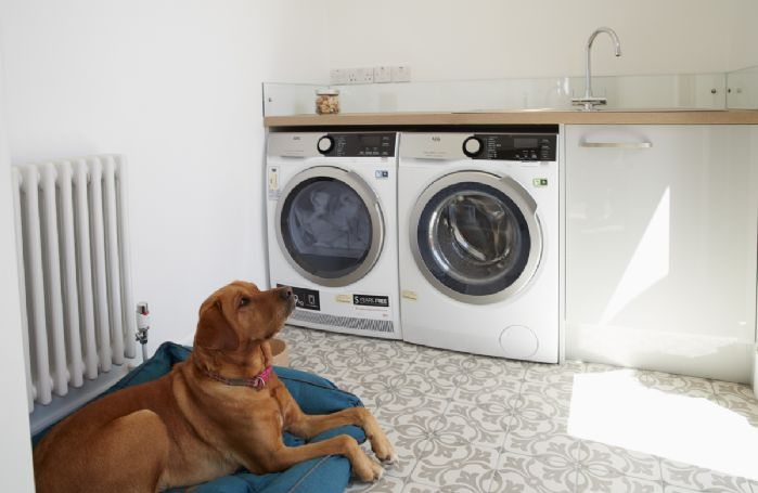 Ground floor: Utility room with washing machine and dryer