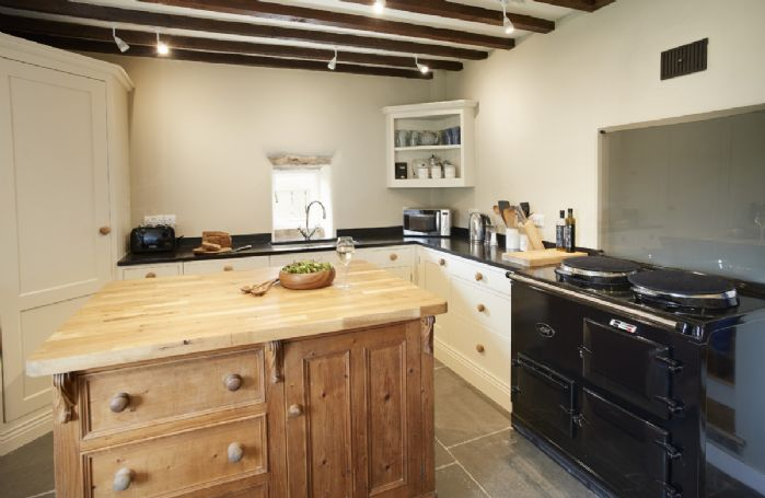 Ground floor: Fully equipped kitchen with electric AGA, large corner fridge, island and original beams