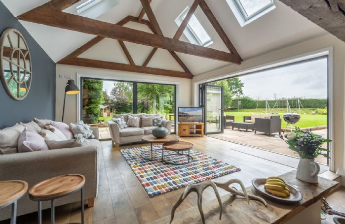 Ground floor: The spacious sofa room with stunning bi-fold doors out to the garden